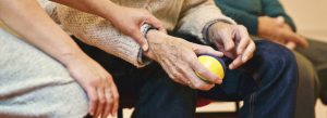 old person holding juggling ball