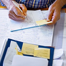 person reviewing calculations on paper