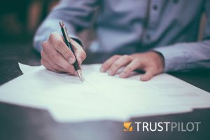 Man filling in form with Trustpilot logo